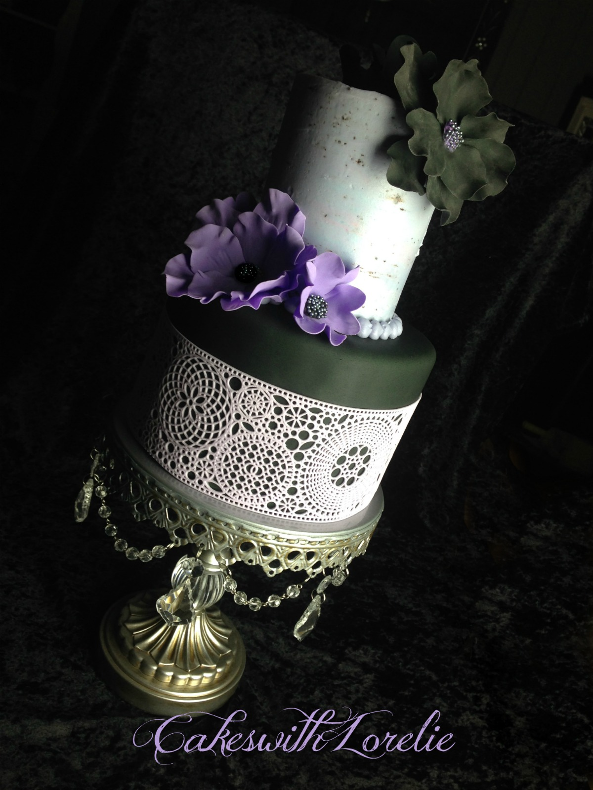 Purple and black gothic style wedding cake