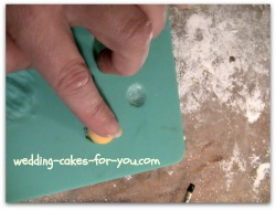 pressing the gumpaste into the Wilton impression mat