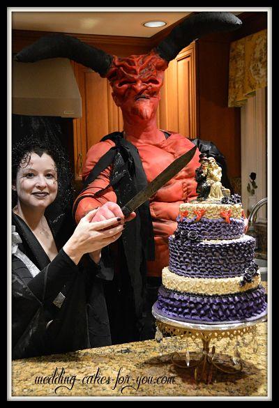 Halloween wedding cake with haunted bride and groom