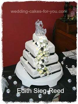 square fondant wedding cake with cascading flowers