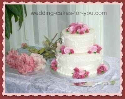Pink roses on a two tiered wedding cake