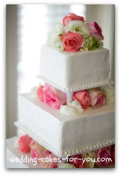 square wedding cake with pink flowers