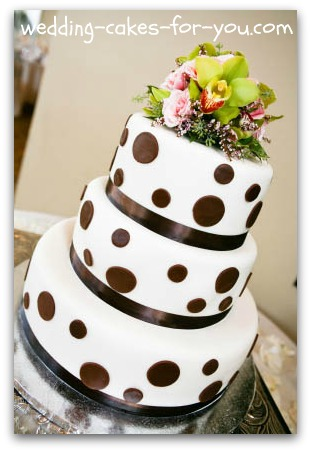 polka dot wedding cake with fresh flowers on top