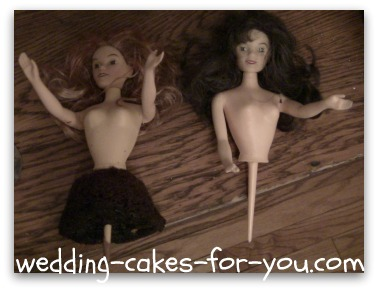doll heads and bodies for a cake