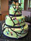 green tiered cake with lovebirds