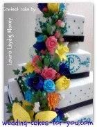 gum paste flowers on a square wedding cake