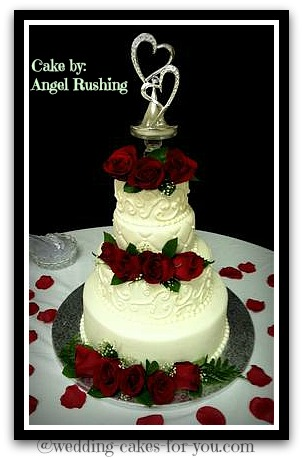 four tiered wedding cake with red roses