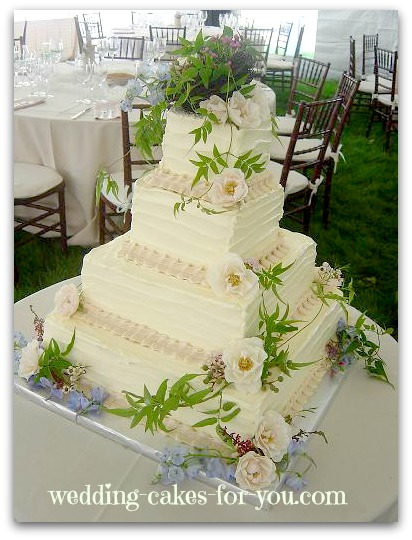 Wedding cakes are like pretty packages square wedding cake with buttercream and fresh flowers junglespirit Gallery
