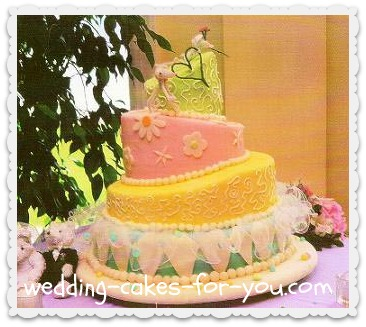 whimsical wedding cake with a pipe cleaner heart