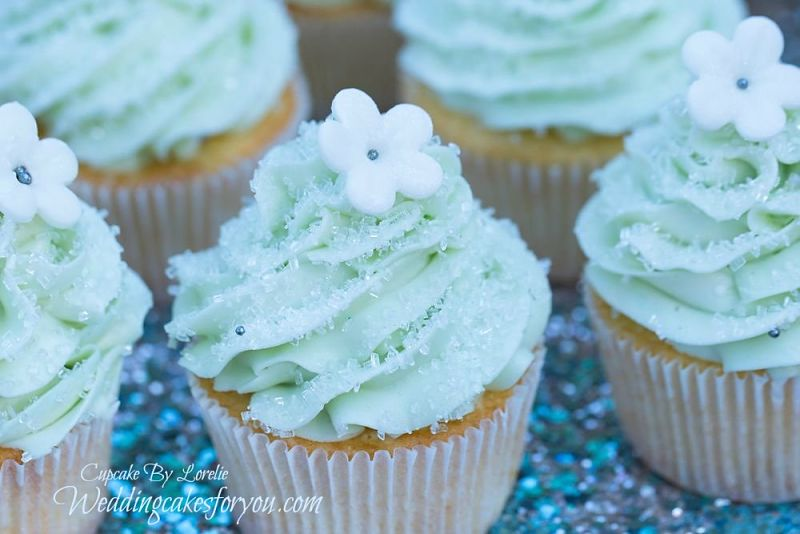 Vanilla cupcakes with soft teal buttercream