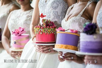 three brides holding wedding cakes