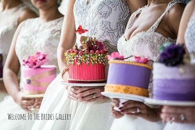 brides holding cakes