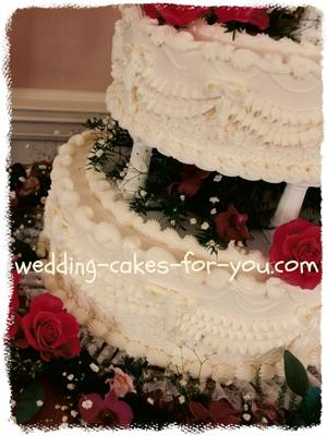 A Wedding Cake Frosted And Decorated With Italian Meringue Ercream