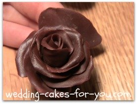 Adding a petal to a chocolate rose