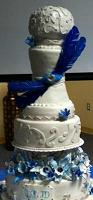 unique wedding cake with blue decorations