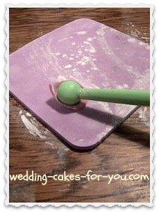 Thinning ou the fondant petals with a ball tool