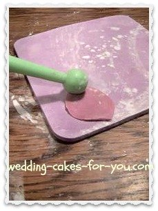 Using the ball tool to thin out the fondant rose petals