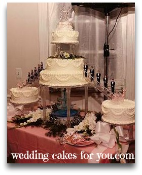 wedding cake with a fountain and stairs