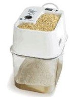 Grain mill for grinding the wheat berries