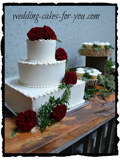 Winter wedding cake with blood red roses