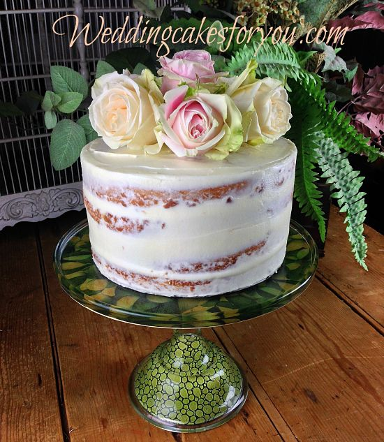 Close up of a naked cake with fresh flowers