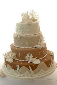 fondant wedding cake with sea shells and sea horses