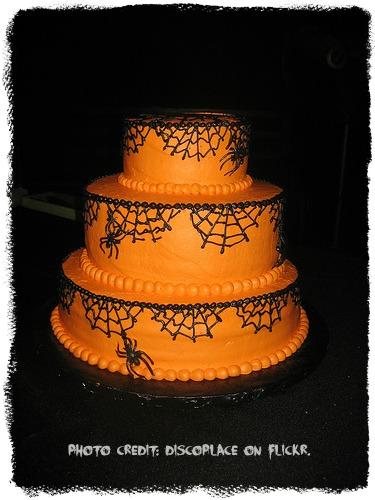 spider web design on an orange halloween cake