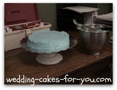 the base cake with blue icing