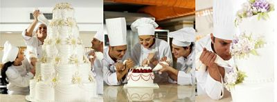 chefs making a wedding cake