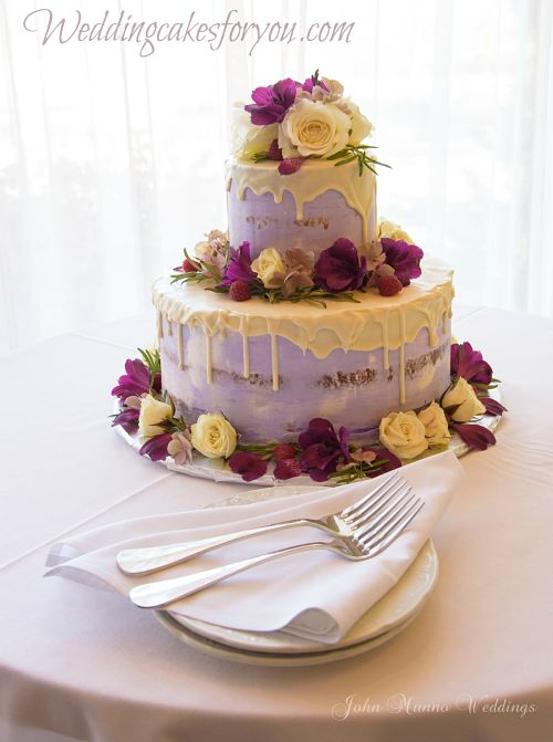 Semi naked wedding cake with white chocolate drip and fresh flowers